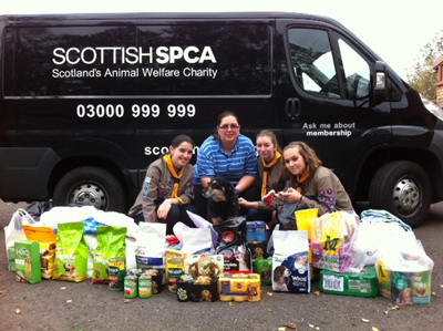 Carluke Scouts delivering donation to the Scottish SPCA
